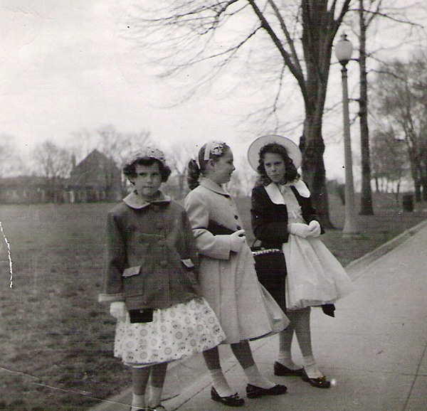 Rivka Olley (right) and two friends standing by the Parade Ground in their Easter finery, ca. 1958.